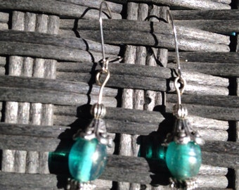 Beautiful blue glass bead earrings with silver tone bead caps and accents