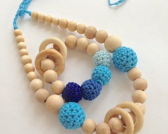 Set of 2. Blue nursing rings necklace and shade of blue teething ring toy.