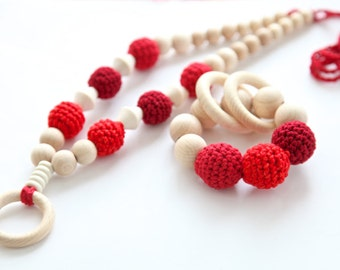 Bright red colorful t set of 2. Teething ring toy and nursing necklace. Multicolor rattle for baby and mom.
