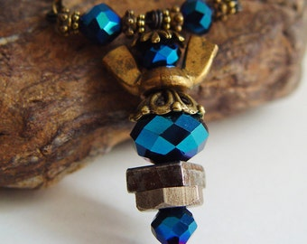 Antique Bronze and Deep Reflective Blue Beaded Wing Nut Angel Necklace