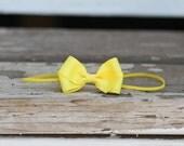 Yellow butterfly headband on skinny elastic