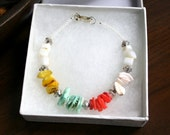 Color Blocked Shell Bracelet.  Ready for spring with yellow, turquoise, coral, and white shells.