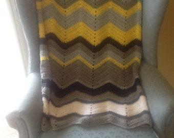 Chevron crochet blanket in mustard, dark gray, light gray and white