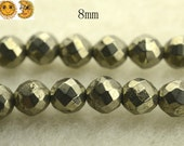 15 inch strand of Iron pyrite faceted(64 faces) round beads,golden brass beads 8mm
