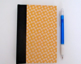 Yellow hardback handbound travel journal notebook or diary with  blank pages