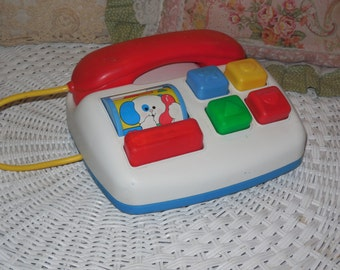 Fisher Price Phone Makes Rattle Noise and Teaches Colors Fun  :)