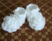 Crocheted baby girl christening linen shoes with flowers and linen lace.