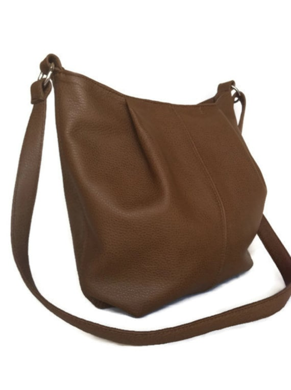 A messenger bag is a little helper to the person who knows exactly where they're going and what they're doing. It is smart and compact, designed to hold exactly what you need for the day, be it a laptop and some documents, or just your tablet and a phone.