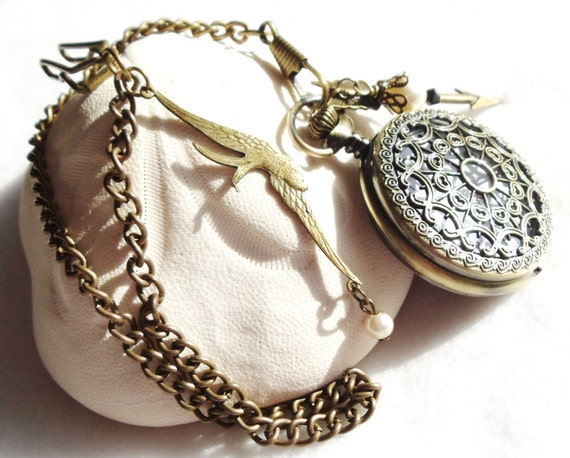 Men's pocket watch with arrow, swallow charms and  pearls