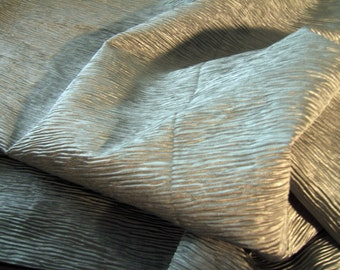 Polyester blend looks like manulipulated fabric