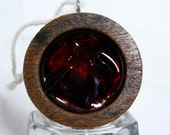 Small mahogany round, filled with black cherry vintage tableware
