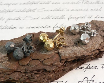 Faceted silver stud earrings