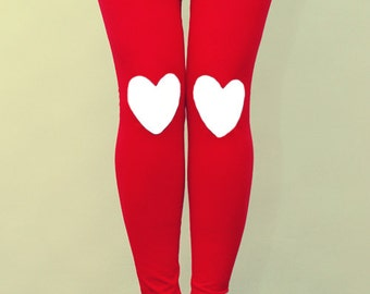 White heart patched leggings in red