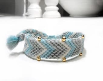 Friendship bracelet in grey, white and baby blue