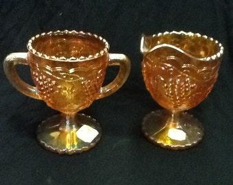 Rubigold carnival glass sugar and creamer set