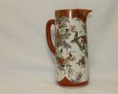 eastern oriental porcelain red orange enameled hand painted pitcher vase
