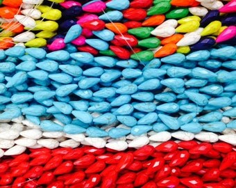 Teardrop howlite turquoise beads, 11x25mm faceted, 16beads
