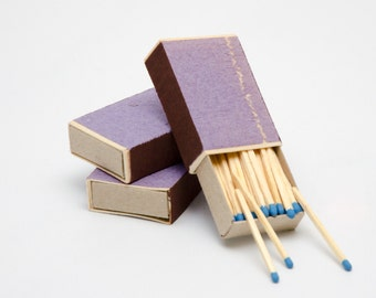 Three matchboxes, wooden matches with sky blue heads inside, striker from two sides, color matchsticks
