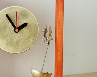 Lovers with umbrella clock, oxidised brass clock with umbrella and couple, brass clock with wooden orange frame, brass sculpture art object