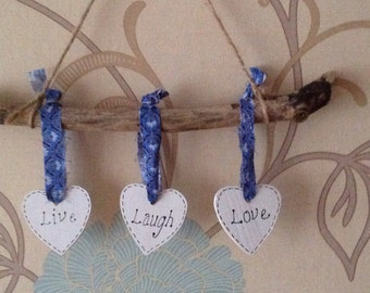 "Driftwood hanging ""Live, Laugh, Love"""