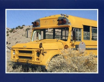 School bus in the desert - photo card