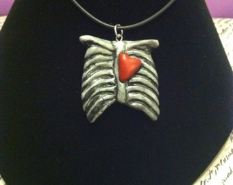 Rib cage necklace in silver or green.