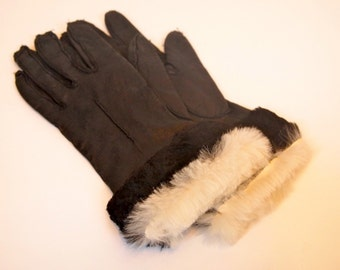 Vintage pair of ladies black leather gloves with genuine black and white fur trim