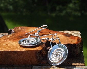 Hammered sterling silver discs with spiral overlay.