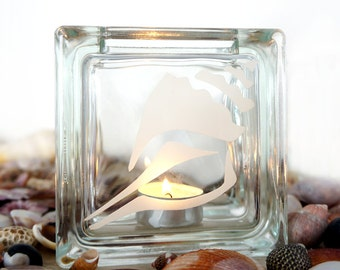 Glass tea light candle holder with conch shell design