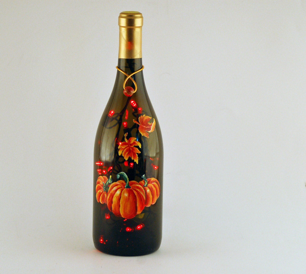 Wine bottle filled with lights hand painted pumpkins and for Painted wine bottles