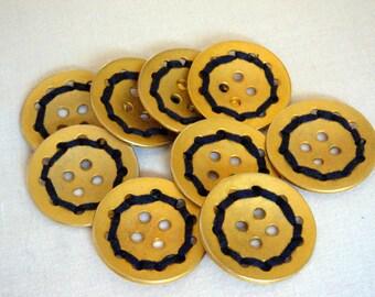 Flat golden buttons with blue thread detail