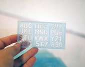 Capital letter stencil alphabet, numbers. Uppercase, upper case abc. Small tiny blue plastic kids stencil. Made in Japan vintage stationery