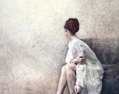 Stay--portrait of a vulnerable woman in a long, white gown, her face turned away