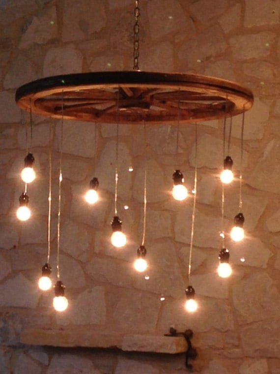 random length wagon wheel chandelier large alternating length wagon wheel mason jar