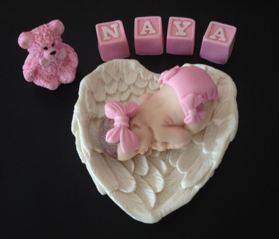 Fondant baby inside angel wings w/letter blocks cake topper