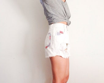 White vintage high waisted distressed shorts with red and blue print patchwork