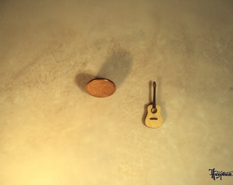 Miniature guitar made of basswood.  (No. MG25)