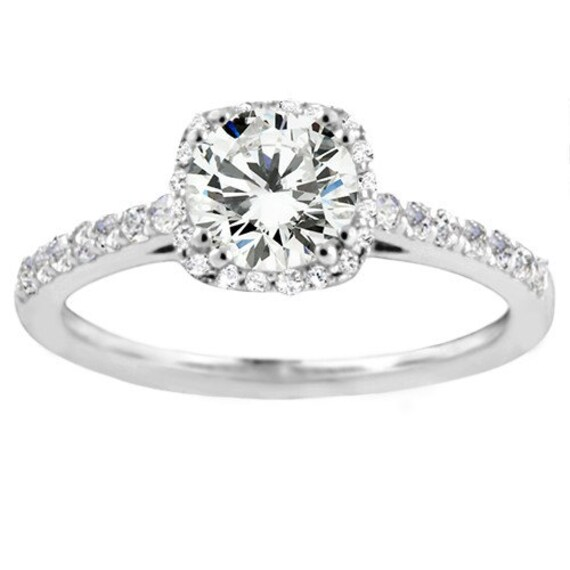 traditional halo 31ctw diamonds w a 1ct rd center prong
