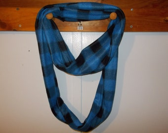 "Infinity Scarf. Flannel blue and black checkered  infinity scarf.  Approx 5"" x 72"".  Great light weight scarf to add color  to your outfit."