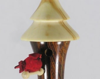 Christmas ornament with a tiered roof.
