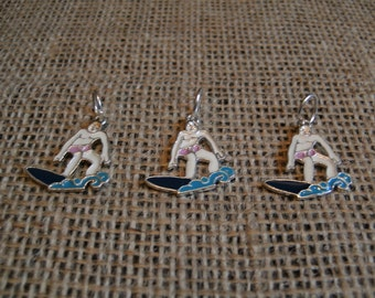 3 surfing charms