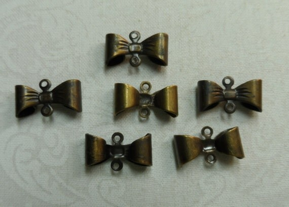 Vintage gold plate d brass bow connectors with rings