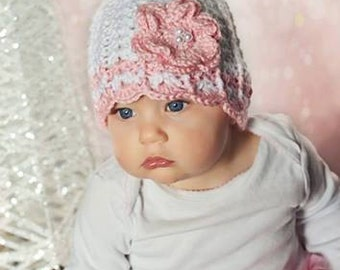 Crochet baby girl hat, newborn girl hat, infant girl hat newborn girl hat with a flower.
