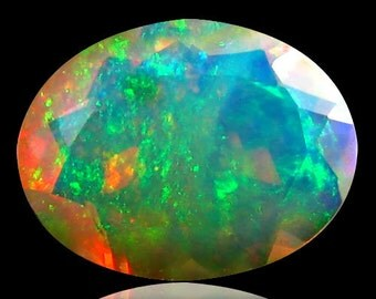 1.40 Carat Weight,  Unique Pattern, Oval Faceted, Fully Flashing, Crystaline Red, Blue, Green, Multi Color, Natural Ethiopian Opal AAA