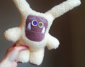 Handmade monster. Bugs, a OOAK softly stuffed plush monster toy in faux lambs wool and 100% wool felt features. Baby safe.