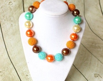 Thanksgiving bubblegum chunky necklace for fall. Girls beaded fall necklace. Pearl and Rhinestone orange aqua brown and cream birthday bead