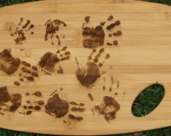 11 x 15 cutting board with childrens hand prints laser engraved. Names included