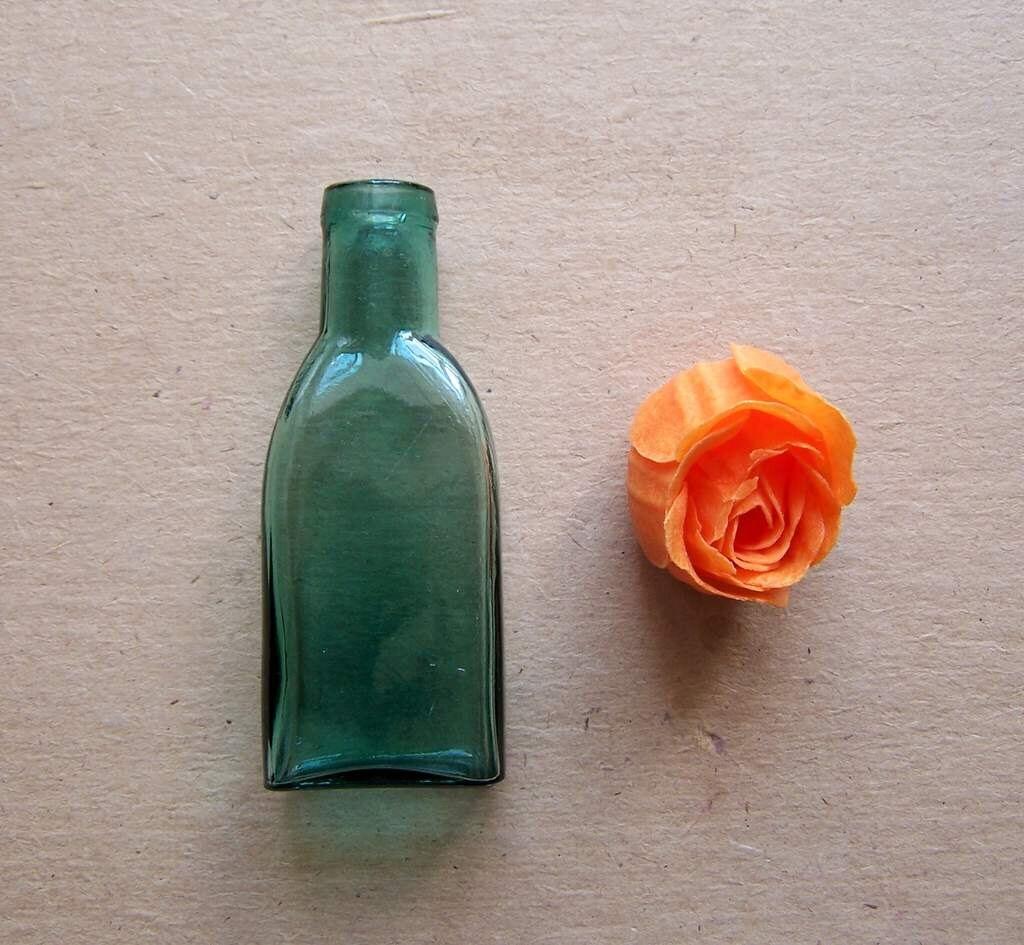 Old green glass bottle for medicine laboratory use home photo for Uses for old glass bottles