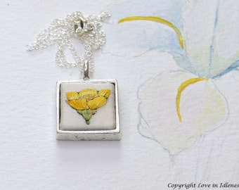 Hand embroidered silk buttercup pendant