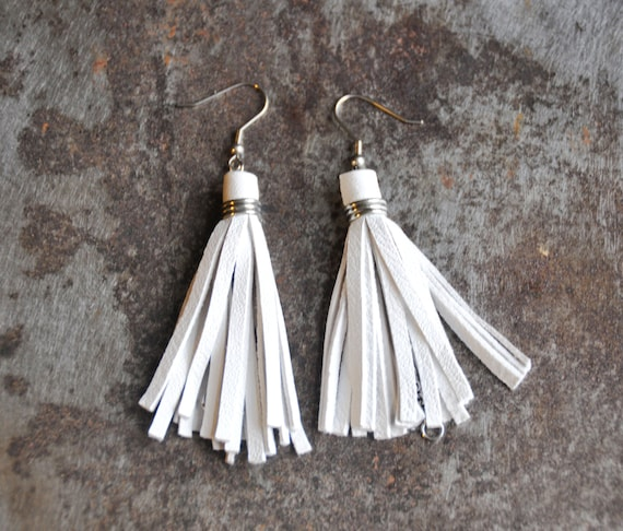 White leather tassel earrings